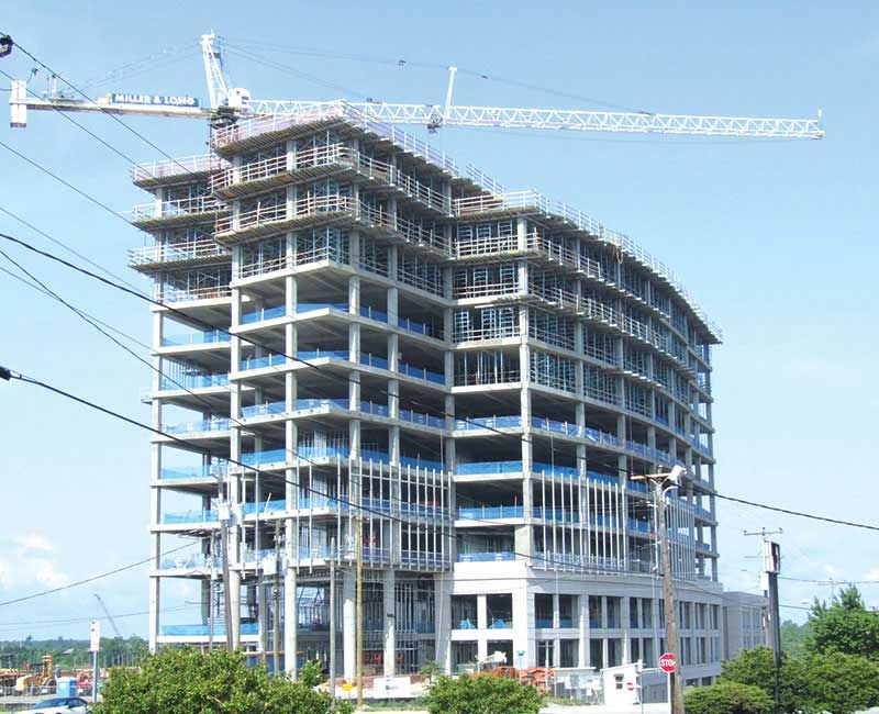 The Corporate Headquarters For Ppd A Global Contract Research Organization Is Shown Under Construction In This File Photo The 12 Story Building Opened On